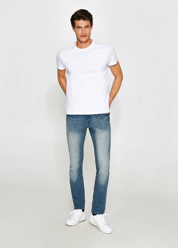 Worn-effect, skinny-fit jeans with fading