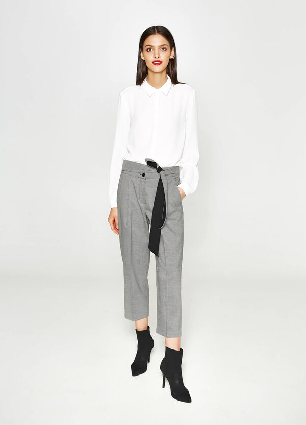 Hound's tooth cropped trousers with crease. | OVS