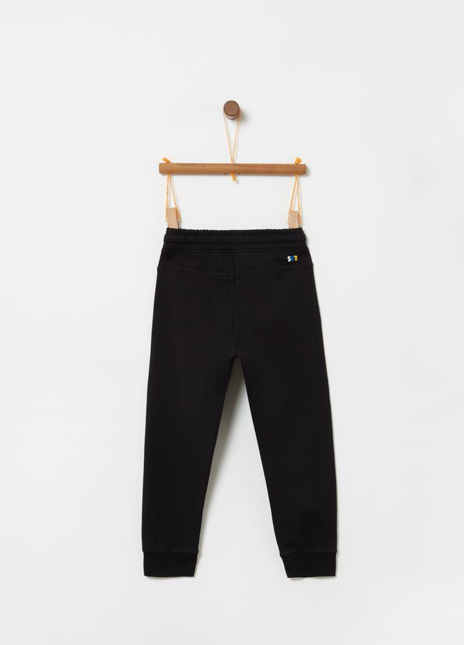 Trousers with pouch pocket and drawstring