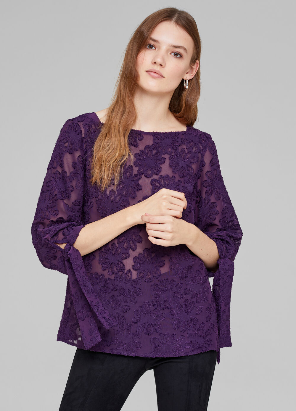 Semi-sheer embroidered blouse