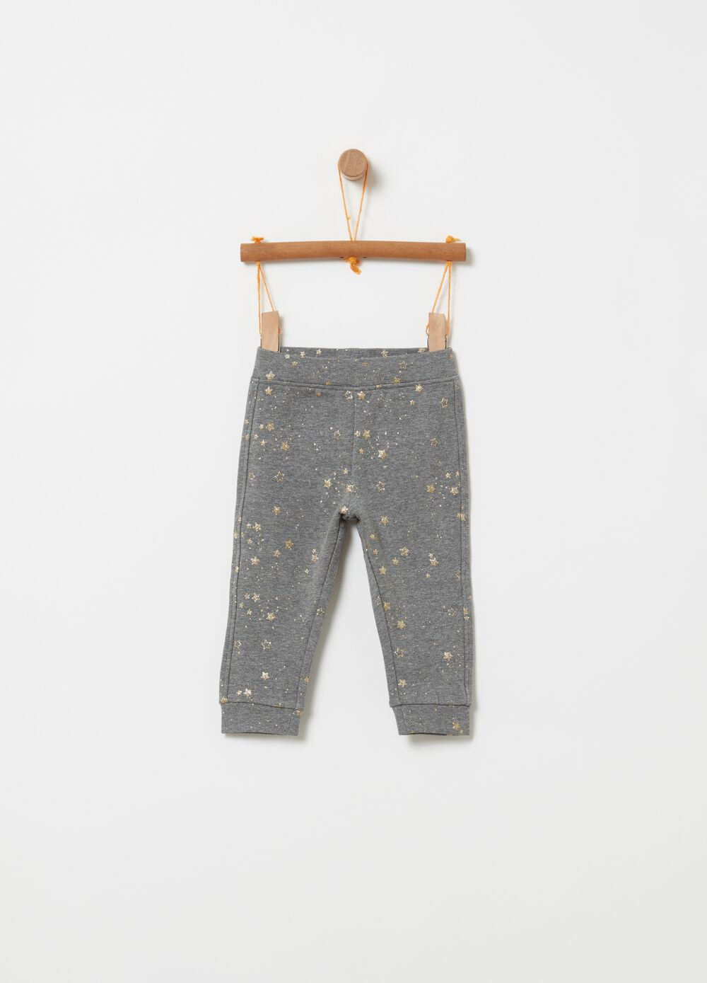 Stretch trousers with stars pattern