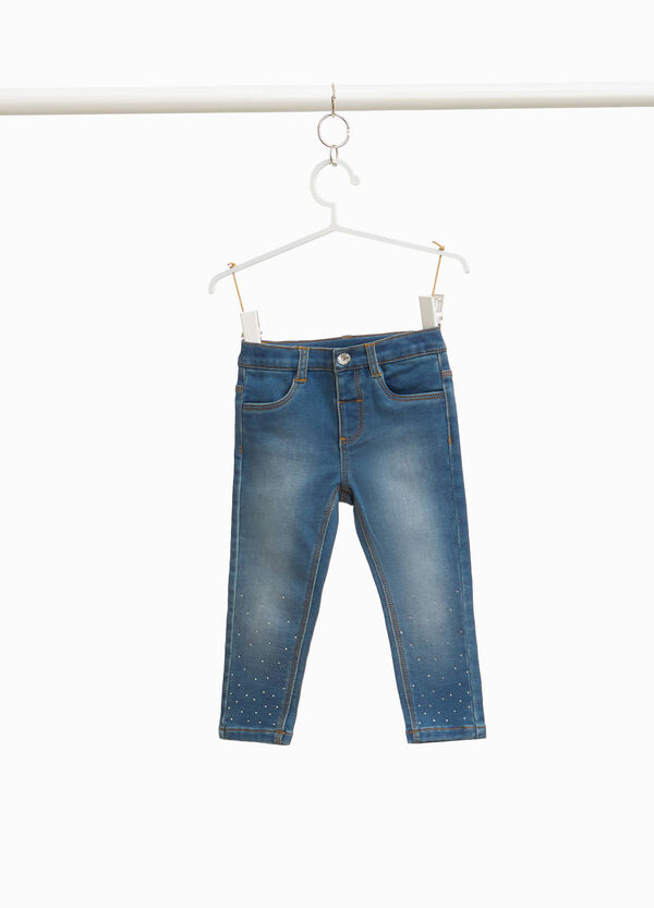 Washed-effect stretch jeans with diamantés