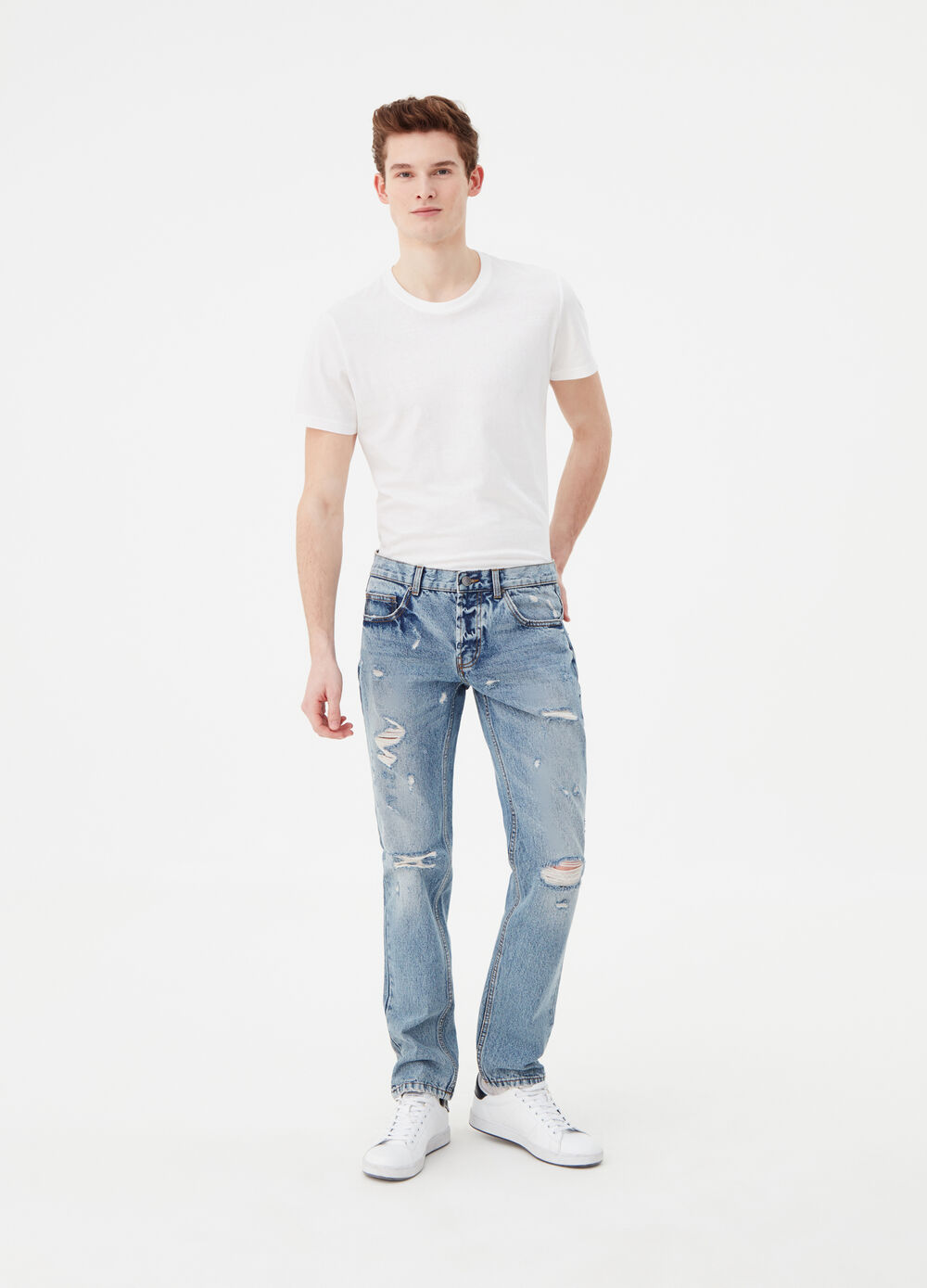 Slim-fit jeans with rips and cuts