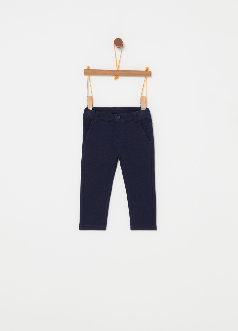 Trousers with welt pockets and button