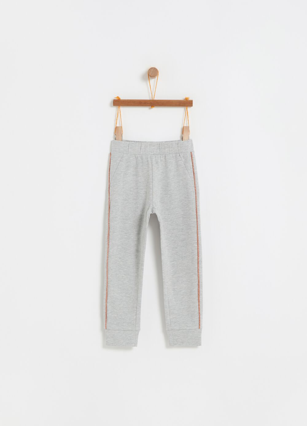 Trousers with pockets and glitter trim