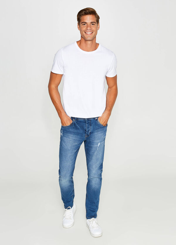 Worn-effect, loose-fit stretch jeans with rips