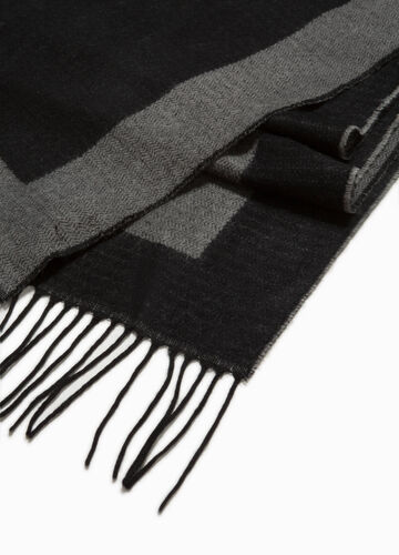 Scarf with geometric weave and long fringes