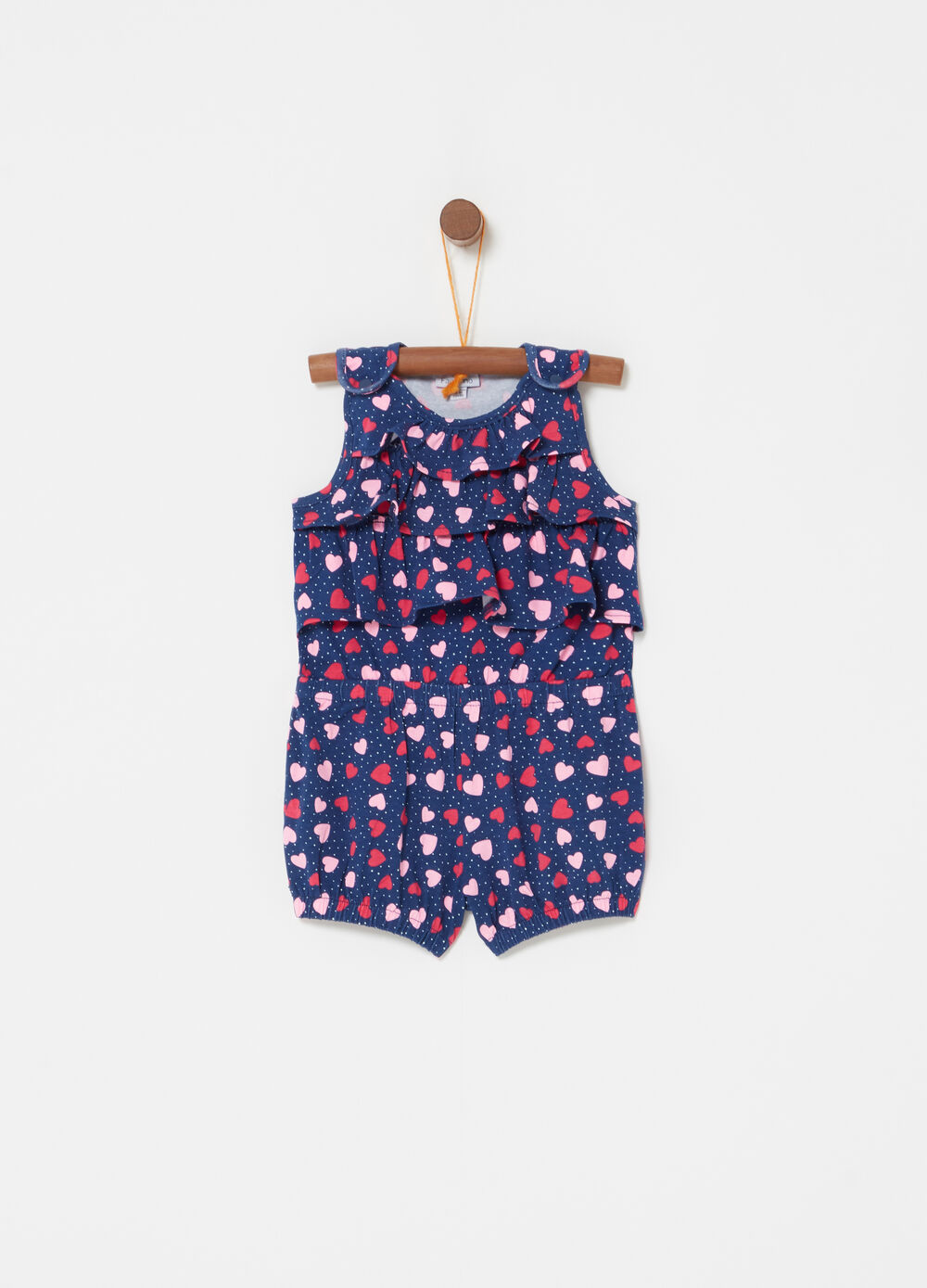 Short onesie with flounce and heart and polka dot pattern