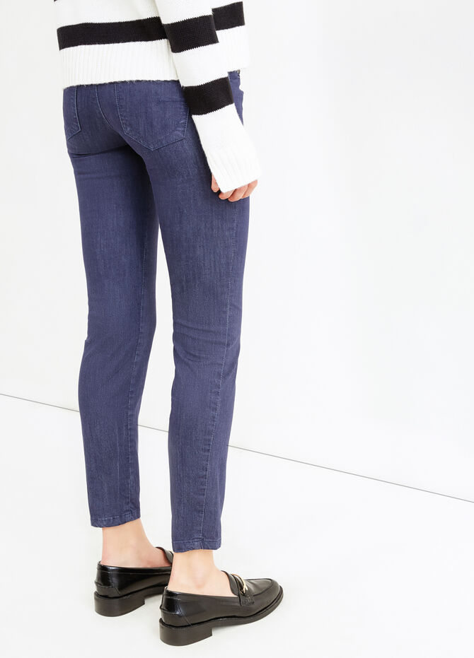 Stretch trousers with pockets and zip