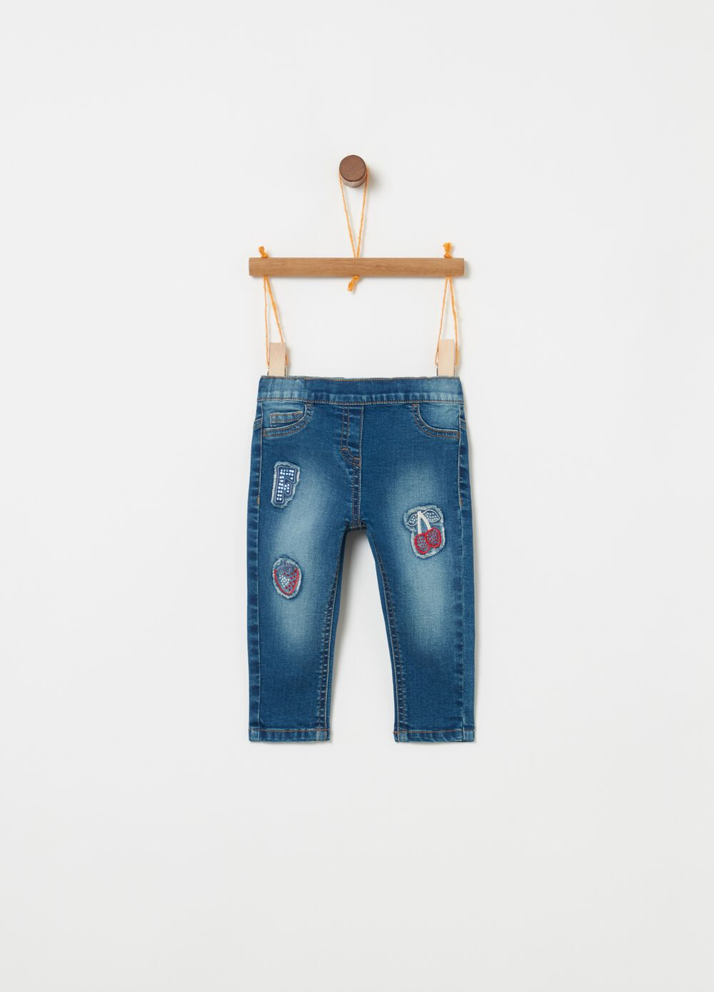 Slim-fit stretch jeans and fruit patches