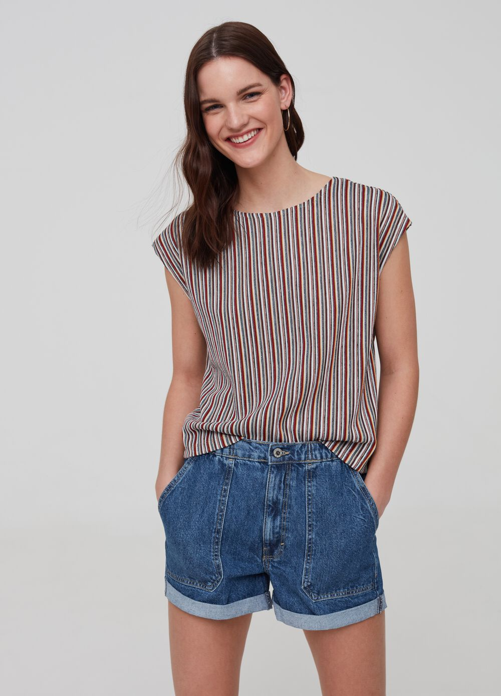 Patterned blouse with cap sleeves
