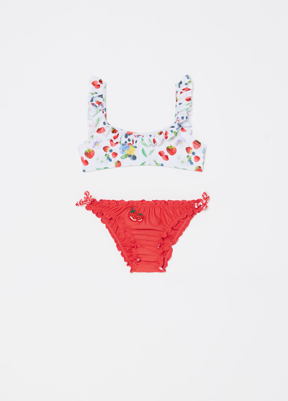 Bikini with fruit patterned top and solid colour briefs