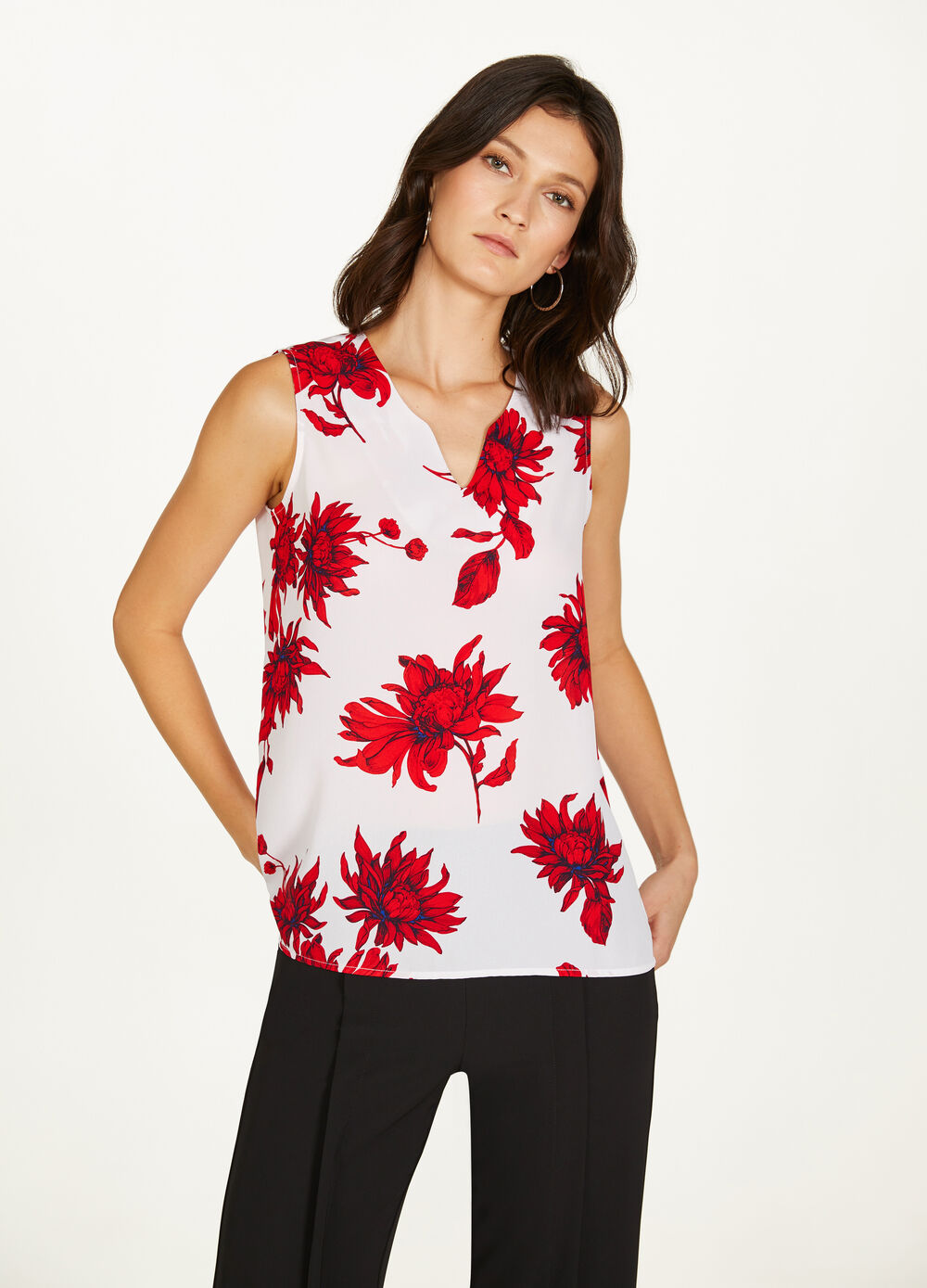 Sleeveless blouse with all-over floral print