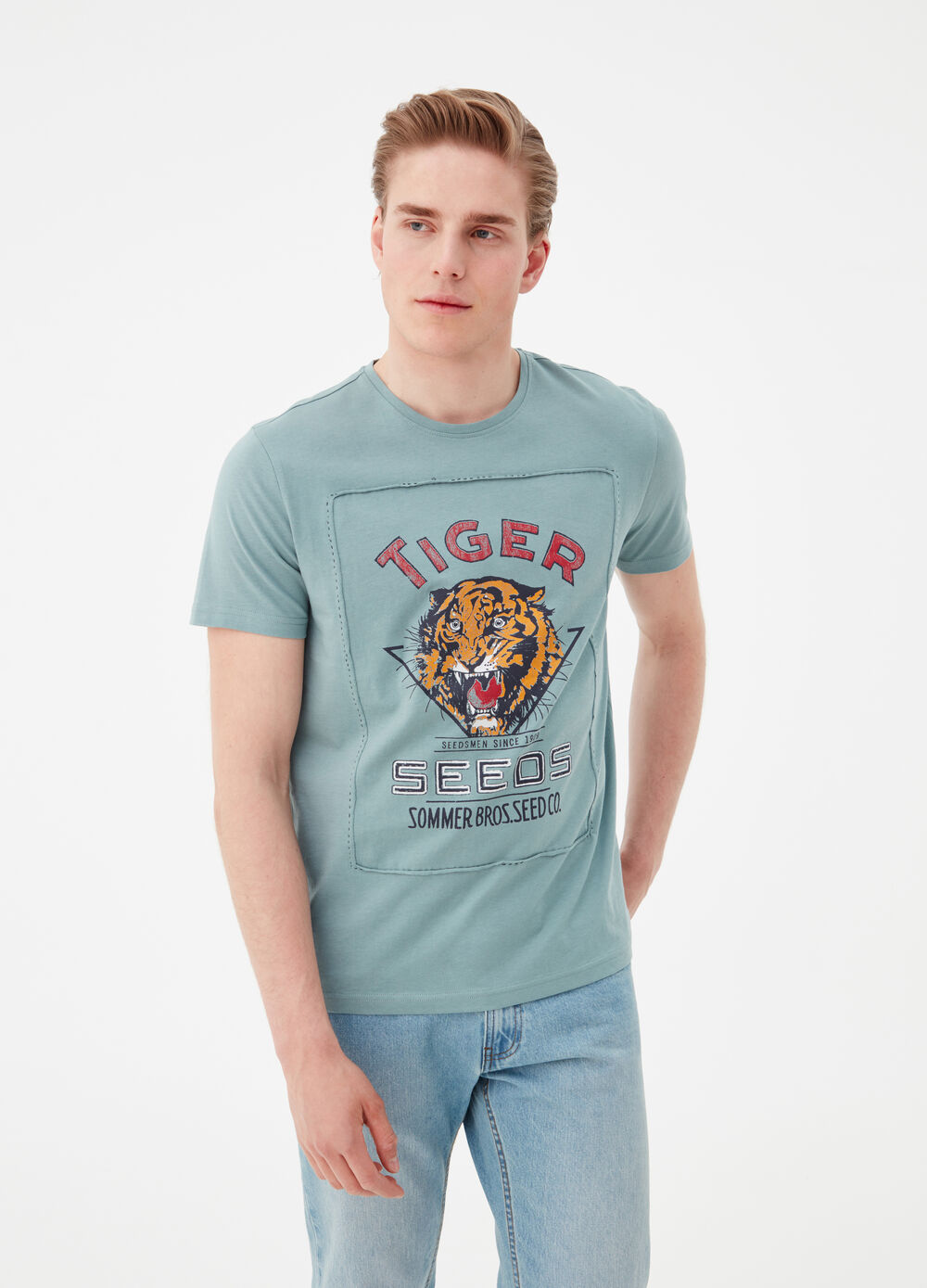 100% cotton T-shirt with hand-stitched insert and tiger