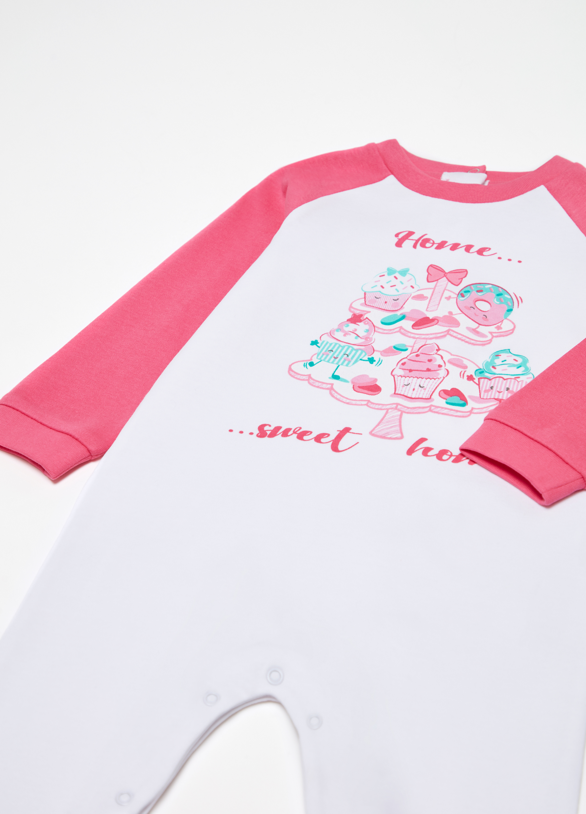 2b7b8bb2be Two-tone onesie with feet and sweets print